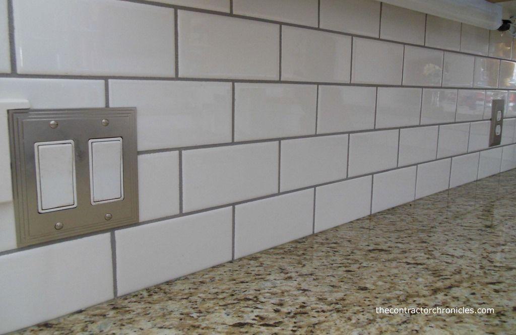 White Subway Tile With Dark Grout Backsplash With Granite