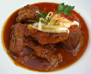 Goulash With Red Wine Sauce Is A Hungarian Food Recipe With Beef Onions And Garlic