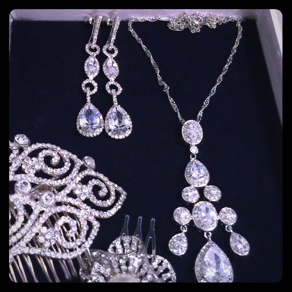 Pear drop chandelier CZ earrings and necklace CZ stones and rhodium plated high grade alloy.  Stunning and shinny in person. Was suppose to be used for my wedding for my reception dress but forgot it at home. Brand new & never used.  Earrings alone retails for $98 at RK bridal studio NYC. Jewelry Earrings