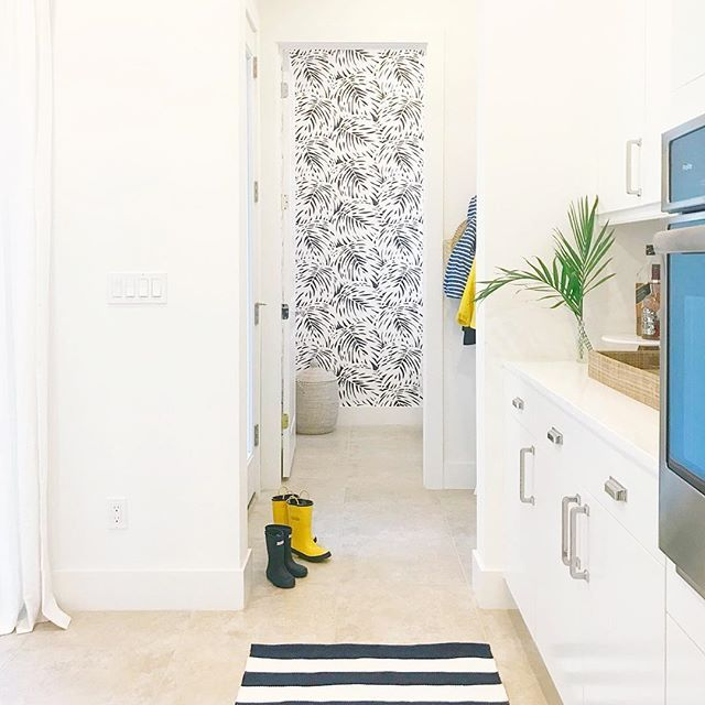 Patterned palm tree wallpaper makes this bathroom pop