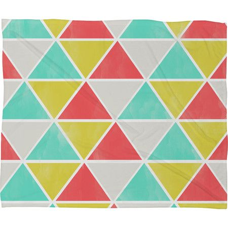 Showcasing a bright geometric design, this stylish fleece throw looks lovely draped over the living room sofa or folded at the foot of the guest bed.