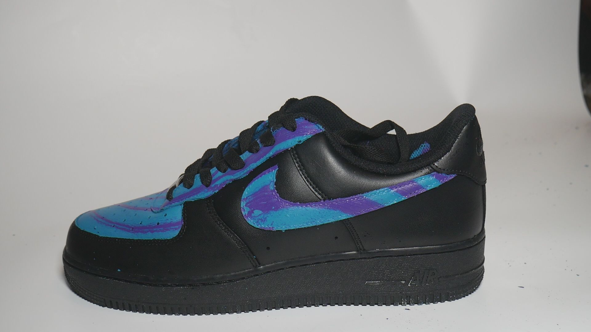 I hydro dipped a black AF1 with blue and purple spray