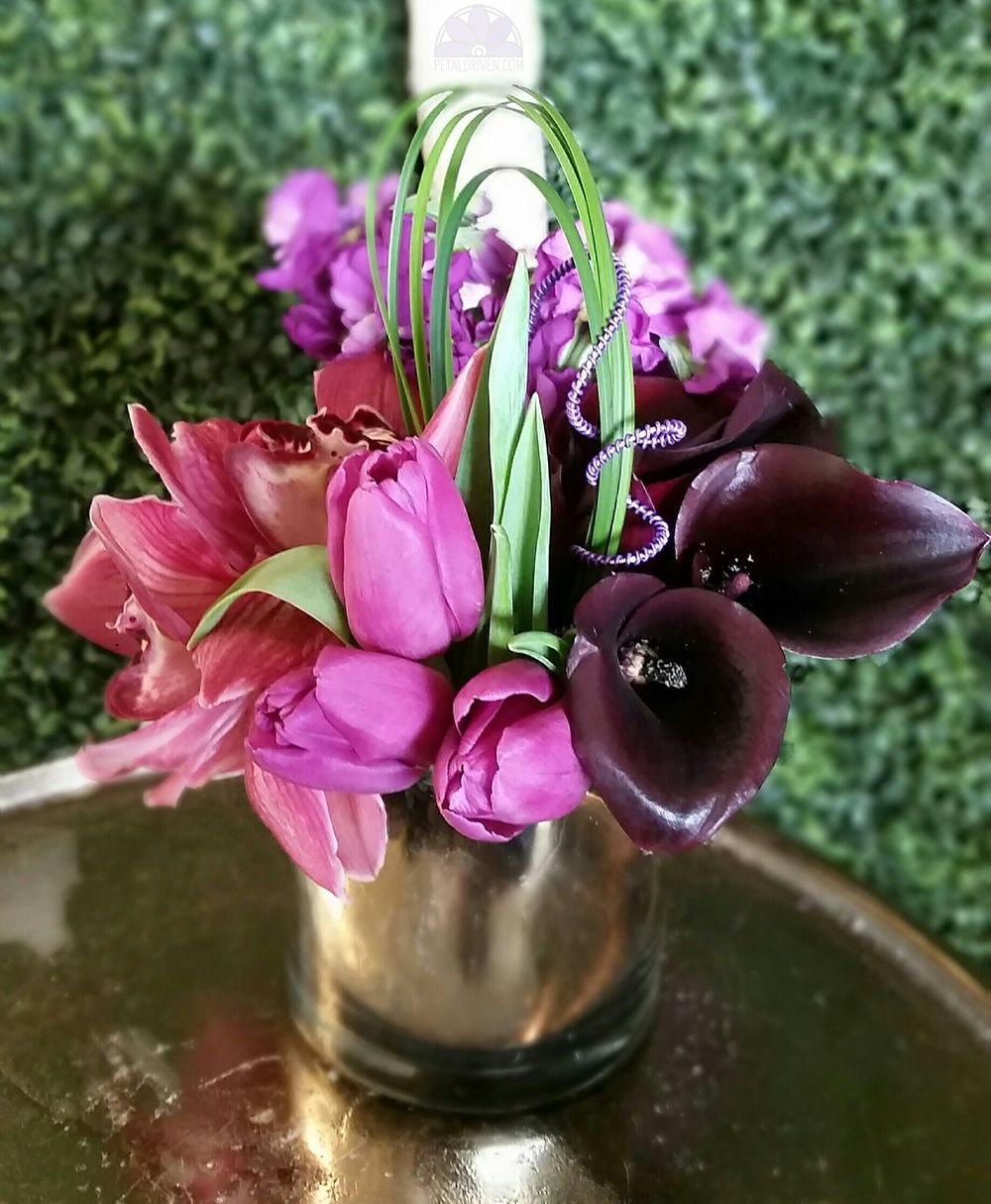 Gorgeous Centerpiece With a Metallic Accent  Tulips Orchids Lily
