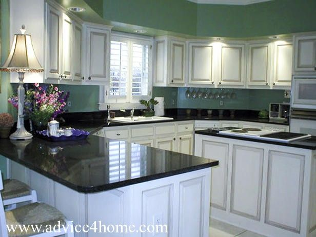 White washed cabinets design and green wall and dramatic black countertops in modern kitchen - White kitchen dark counters ...