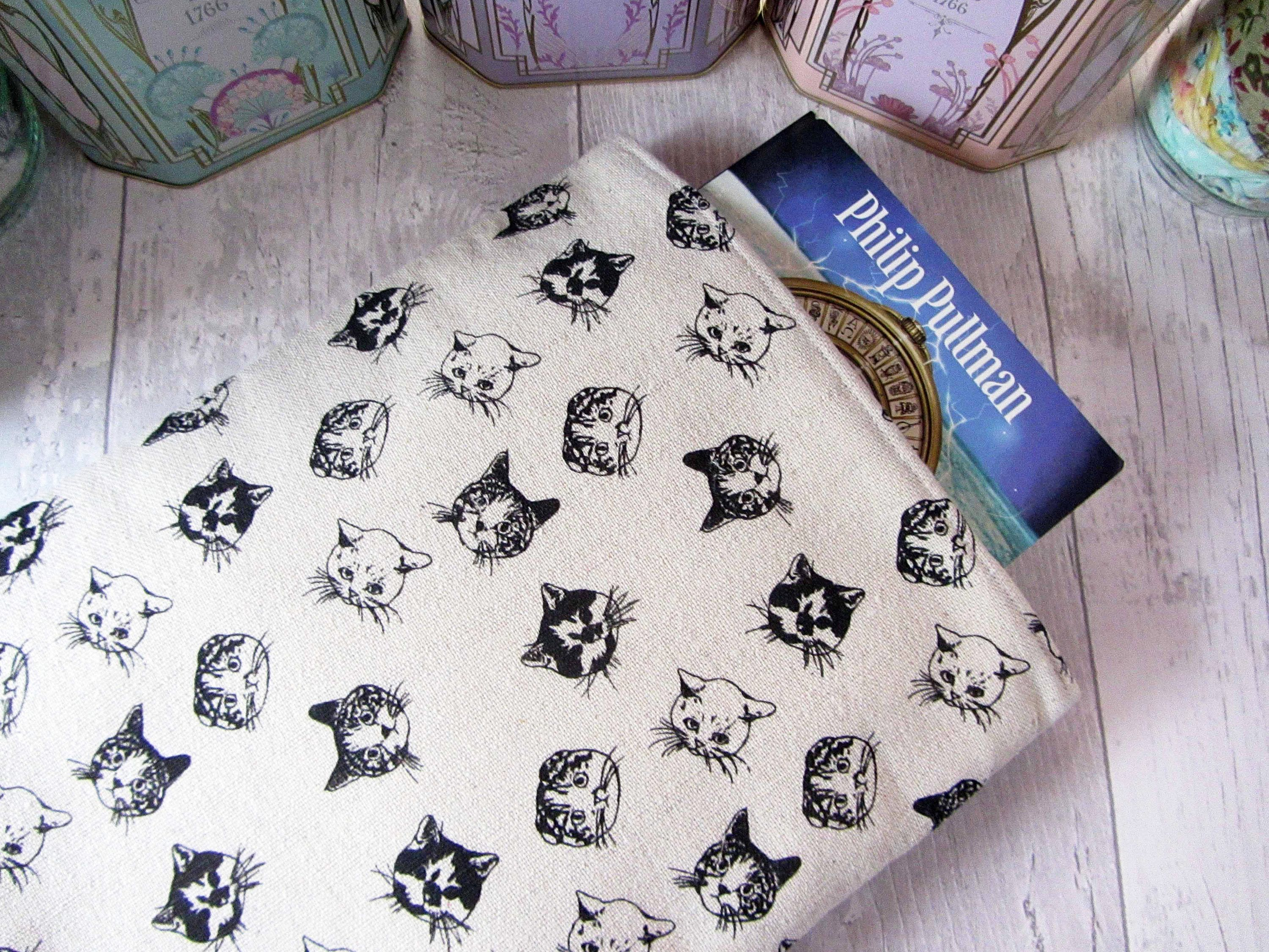 At last My cat fabric is back in stock and I m able to