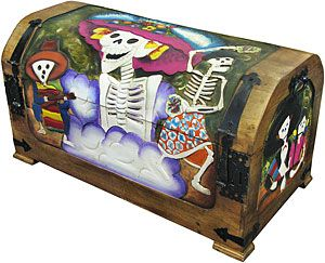 Stow away your treasures in this treasure of a chest!  Meticulously hand-carved and hand-painted in central Mexico, this charming Day of the Dead trunk is the perfect way to infuse your home decor with bold south-of-the-border flair!  A pleasing coffer to stash your cache, you can store all of your collectibles and heirlooms...even your stockpile of old Halloween costumes! Keep it at the foot of your bed or in your favorite cozy corner, anywhere you want to add color and culture to your home.