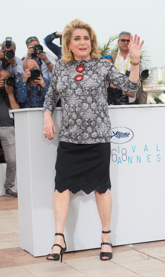 """The legendary French actress is at the festival to promote her new film, """"La Tete Haute (""""Standing Tall""""). She wore head-to-toe Louis Vuitton (she was in Palm Springs for the brand's resort show) and told  reporters that she's mourning the """"death of glamour."""" She said: """"I detest selfies, photographing yourself all the time ... it makes everything banal."""""""