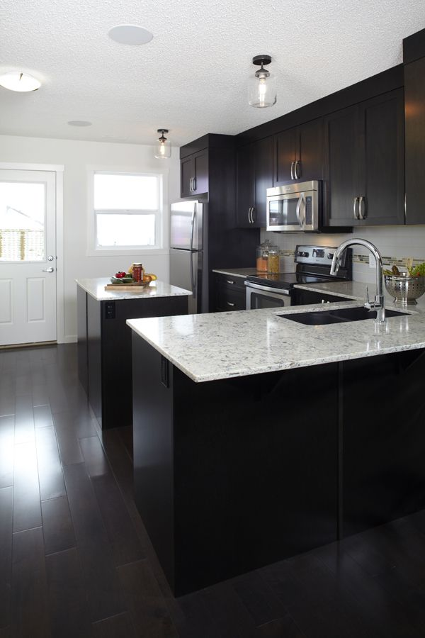 Dark Cabinets Sleek Quartz Countertop