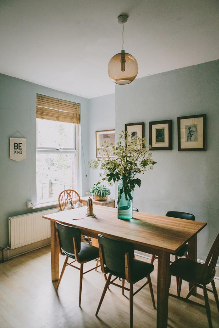 Lovely Dining Room With Cool Blue Walls And Green Dining Chairs