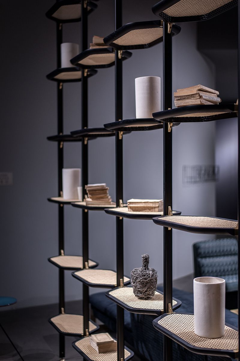 Floorceiling mounted metal bookcase libelle baxter joinery