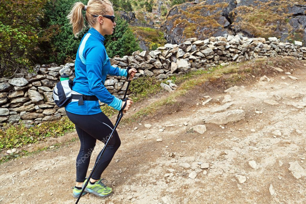 Woman nordic walking on country trail Royalty Free Stock Images ,