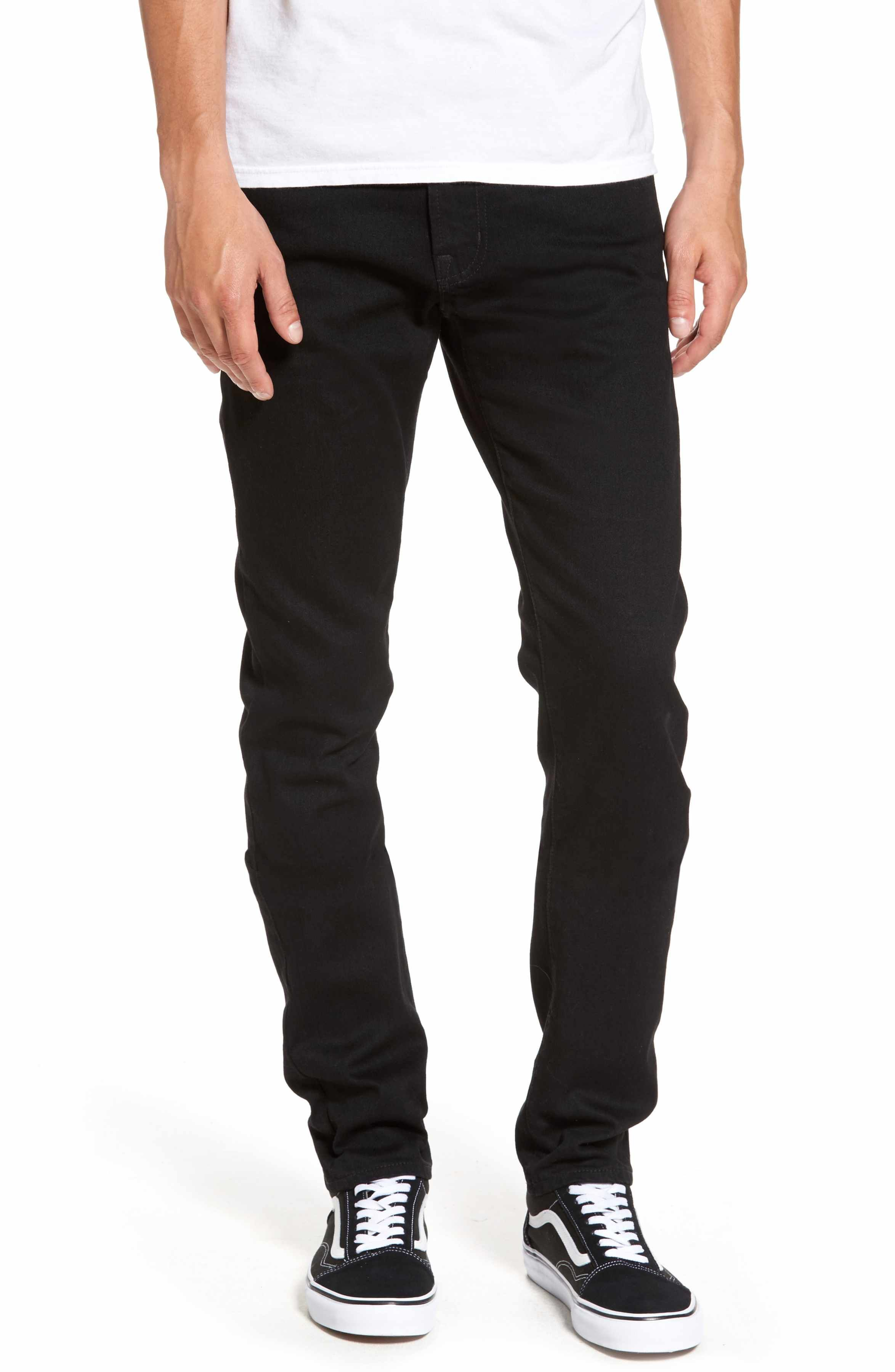 979b02b843 A deep black wash adds clean style to versatile jeans cut in a slim ...