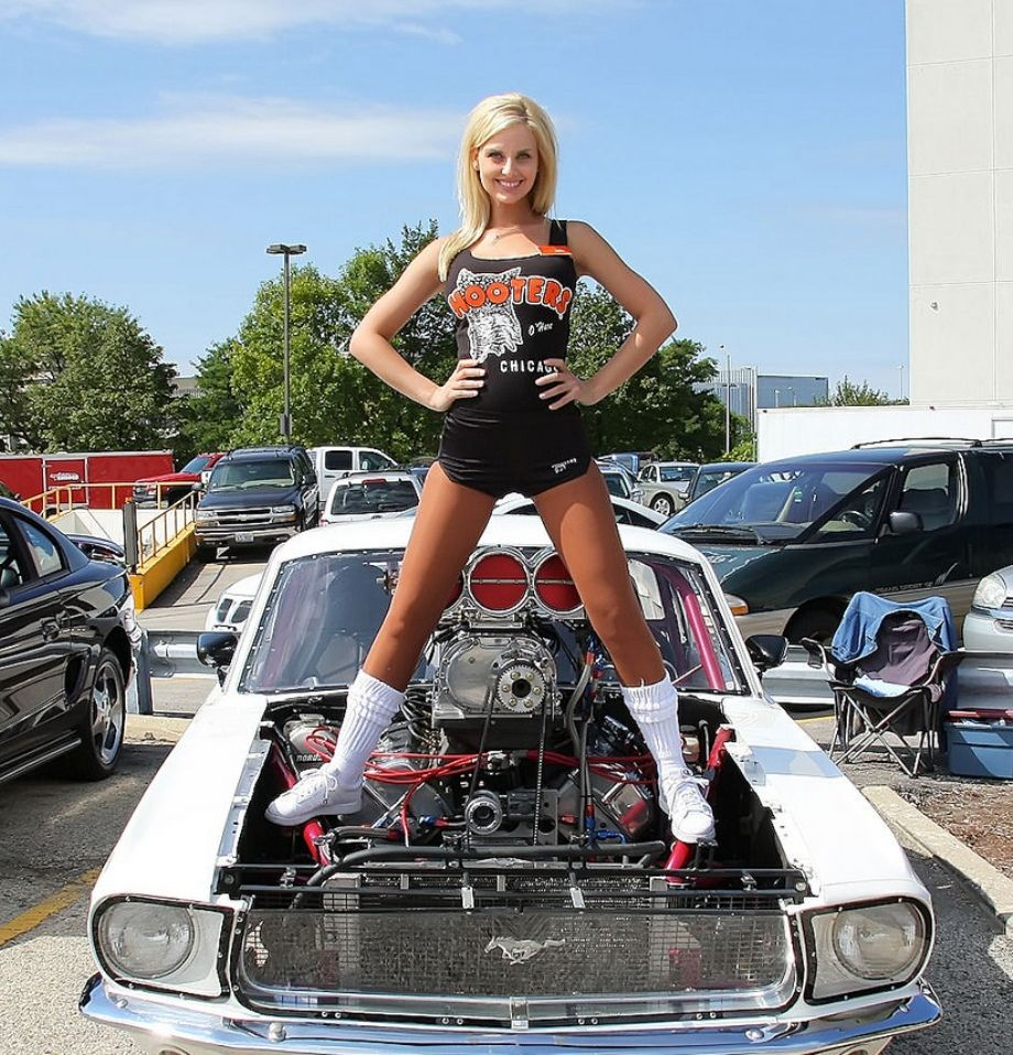 Ladies posing with cars .. Can we if we don't get OVERBOARD ...