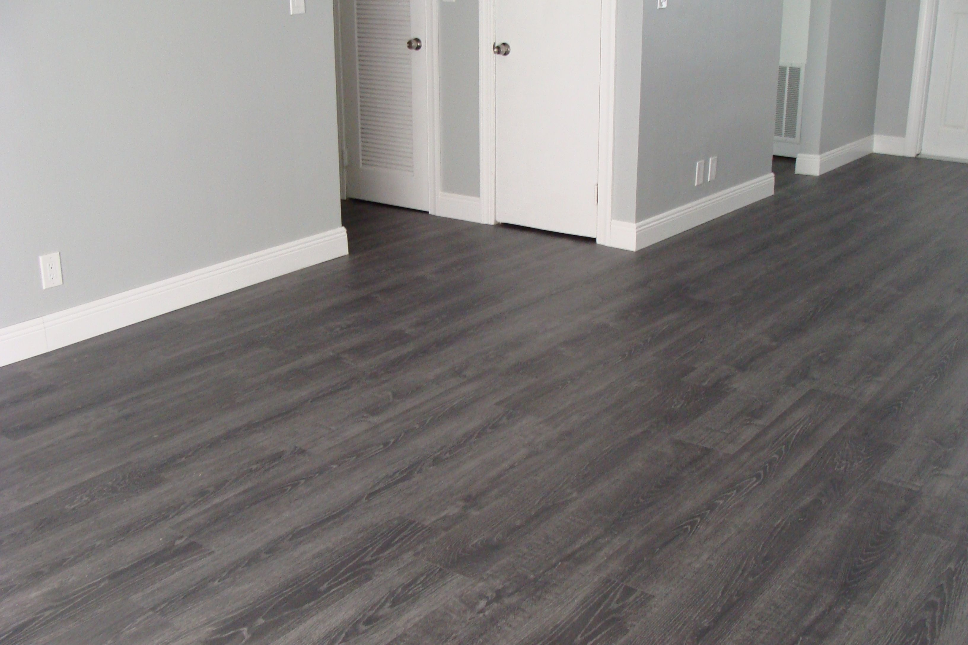 Tokyo Oak Grey Laminate Is The Perfect Complement In Vincent S S Home Laminate Grey Flooring Mo Grey Laminate Flooring Grey Hardwood Floors Grey Flooring
