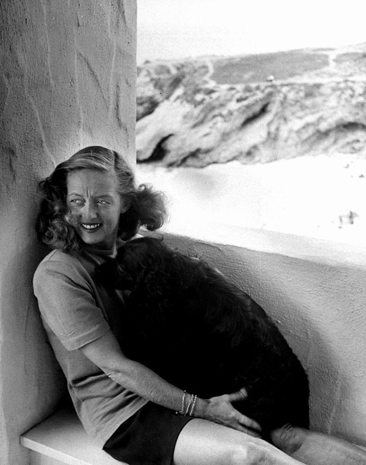Ravageuses have pets. | Bette Davis by Loomis Dean