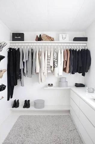 this minimalist closet is absolutely stunning.