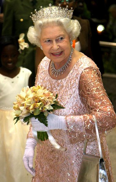 Queen Elizabeth II Photos Photos - HRH Queen Elizabeth II smiles as she arrives for a State Banquet at State House on November 22, 2007 in Entebbe, Uganda. The Queen will open the Commonwealth Heads of Government Meeting on Friday. CHOGM will be attended by over 5000 delegates, The Prince of Wales and Duchess of Cornwall as well as UK Prime Minister Gordon Brown. - Royal Trip: Commonwealth Heads Of Government Meeting: Uganda - Day 2