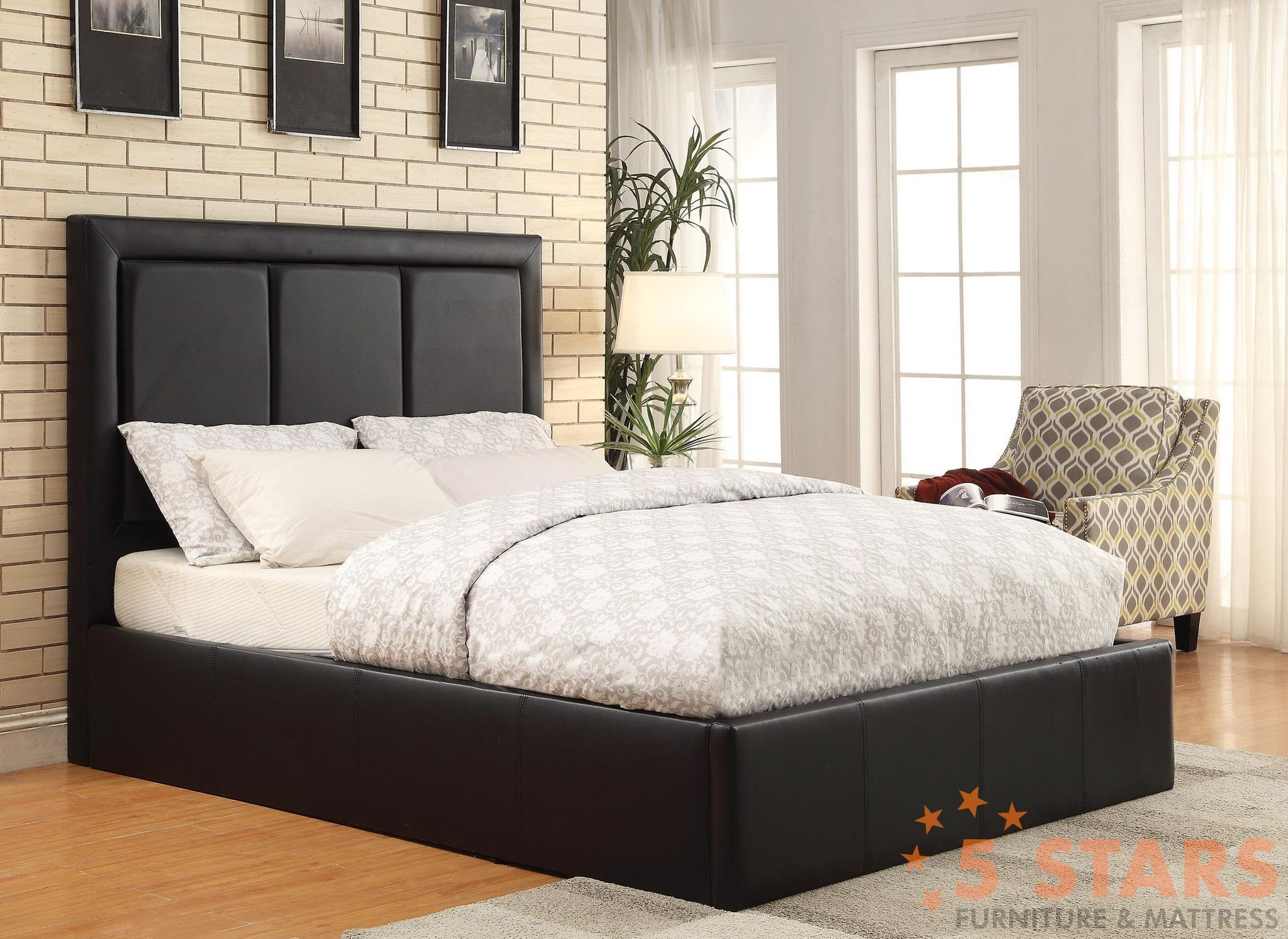 This upholstered queen bed is a perfect stylish addition to a