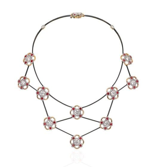 """James de Givenchy for Sotheby's Diamonds, a """"flower""""necklace using platinum, gold, steel, diamonds and pink sapphires."""