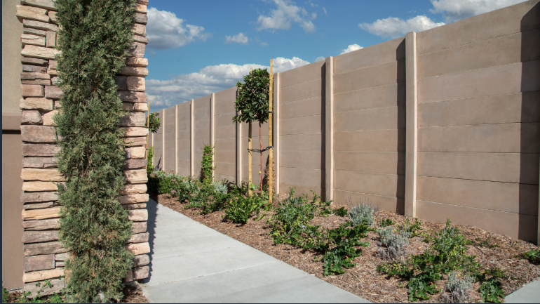 You Don T Need A Stone To Build This Smooth Stone Wall Precast Concrete Does The Trick At A Fraction Of Modern Fence Design Concrete Fence Wall Concrete Fence