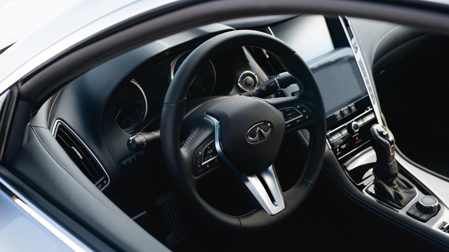 Premium Graphite Leather Wrapped Steering Wheel With Power Tilt And Telescopic Steering Column Infiniti Usa Infiniti Coupe