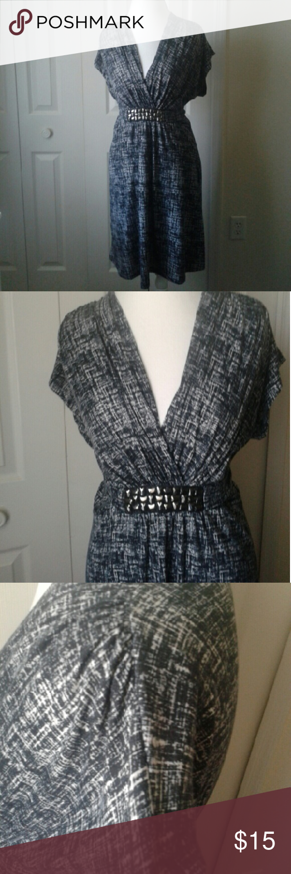 """**SALE**Charcoal gray and white dress Dark charcoal and white design. Sash ties back at the waist. Falls above the knee.  Ruched sleeves and v-neckline (flatters chest and upper arms) Length:37"""" Dresses"""