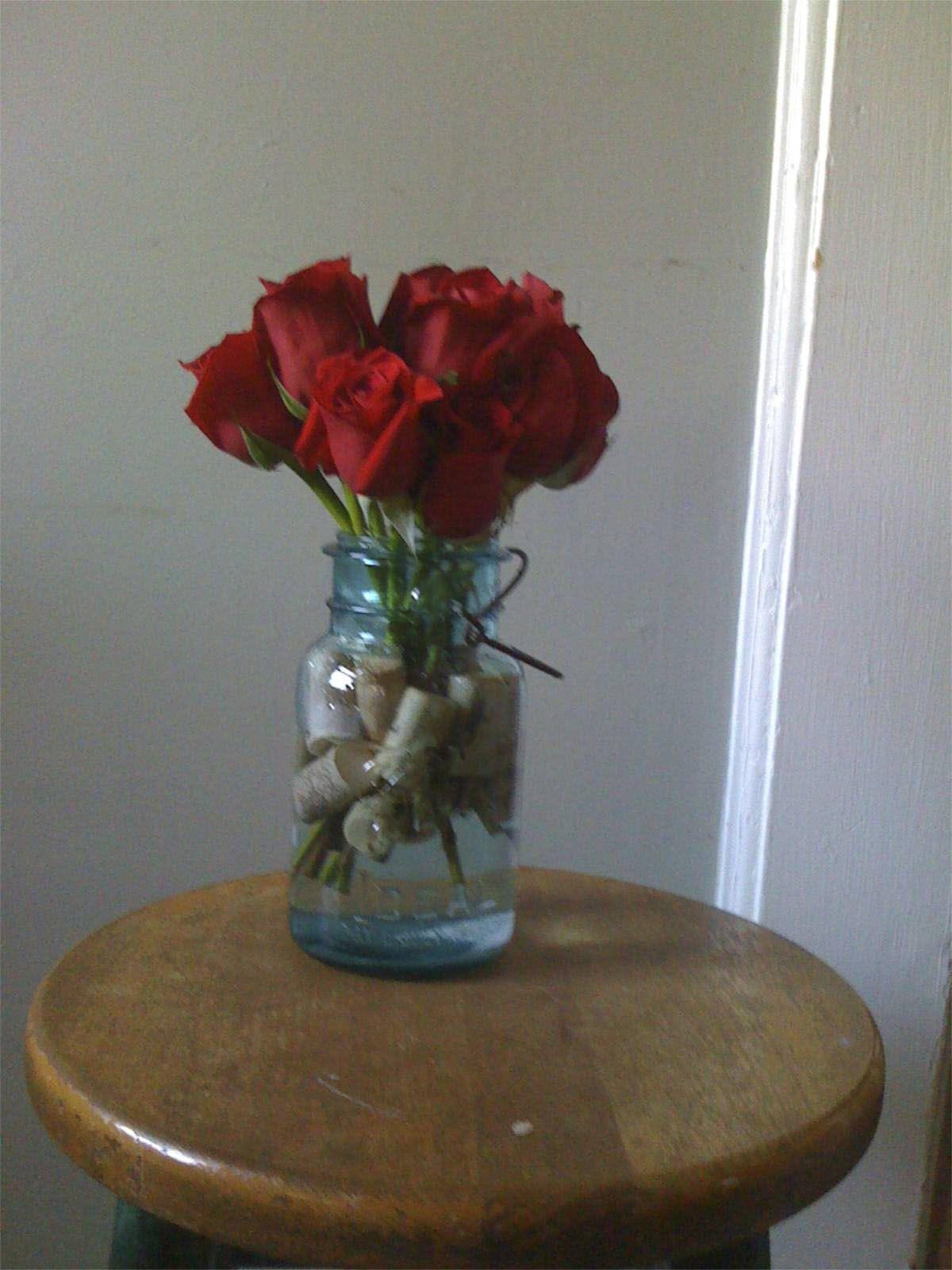 Roses In Blue Mason Jar Centerpiece Wedding Ideas Wine Cork Wedding Wedding Shower