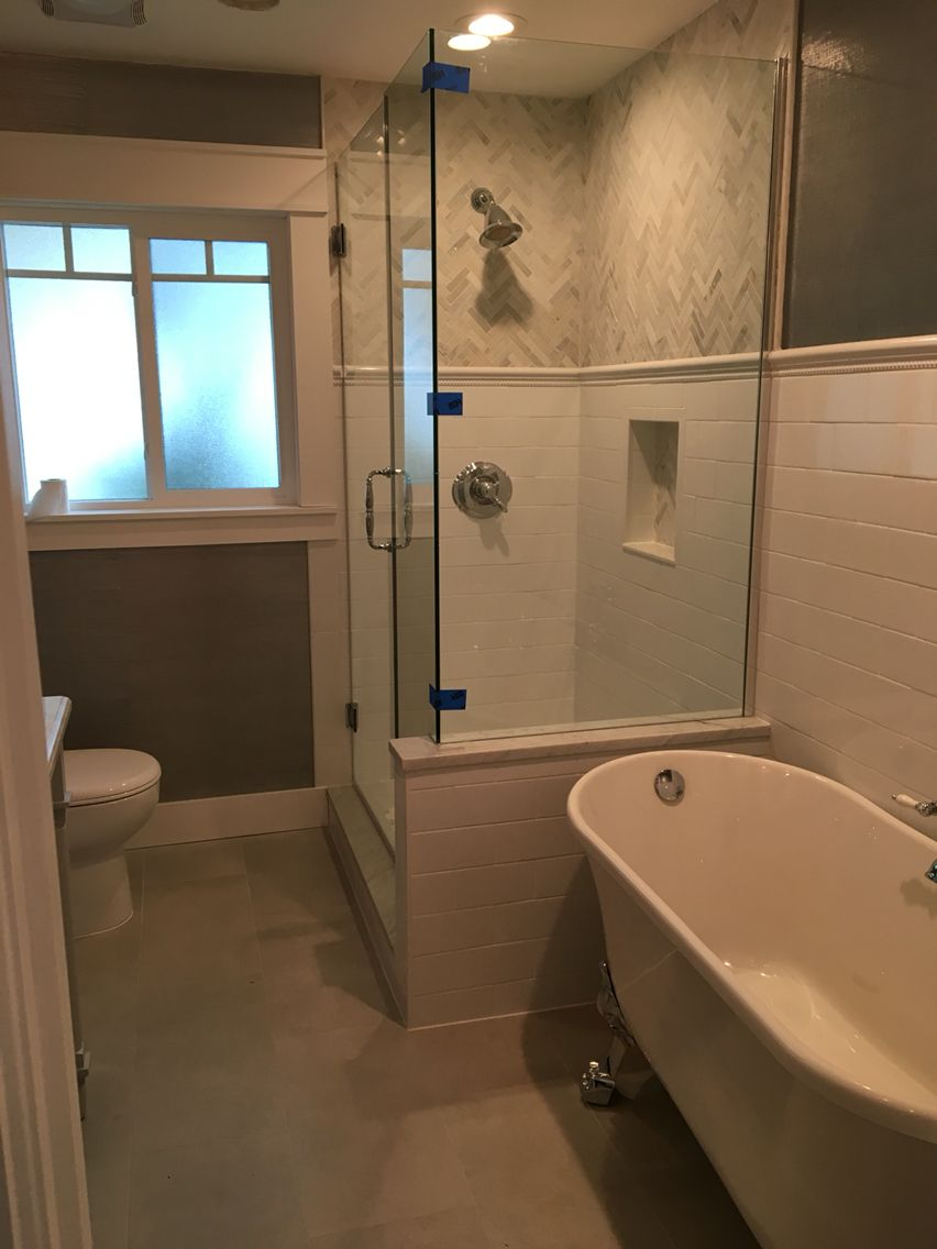 Transitional bathroom with clawfoot tub and chevron tile in the ...