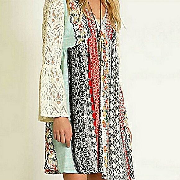 Bohemian style patchwork dress Stop right here! We have found the perfect Spring dress! Bohemian style patchwork print and contrasting lace sleeves make this dress the absolute best for festivals and fun! Perfect length for all sizes. True to size, with a little extra room!   Long Lace Bell Sleeves * Floral Print * V-Neck Neckline with Crochet Detailing * 50% Cotton * 50% Nylon * Machine Wash Cold * Tumble Dry Low * No Bleach Dresses Midi