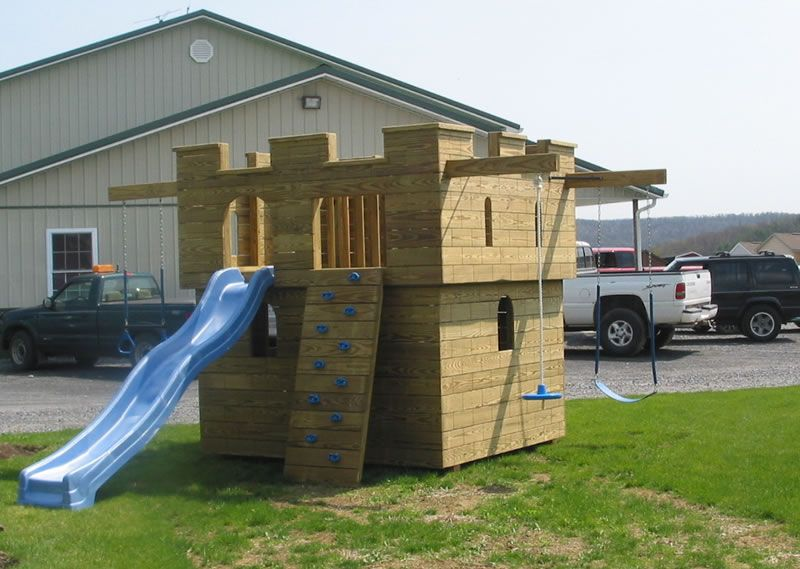 Really Fun Playhouse With Swings, Rock Climbing, Slide And Deck To Look Out  On