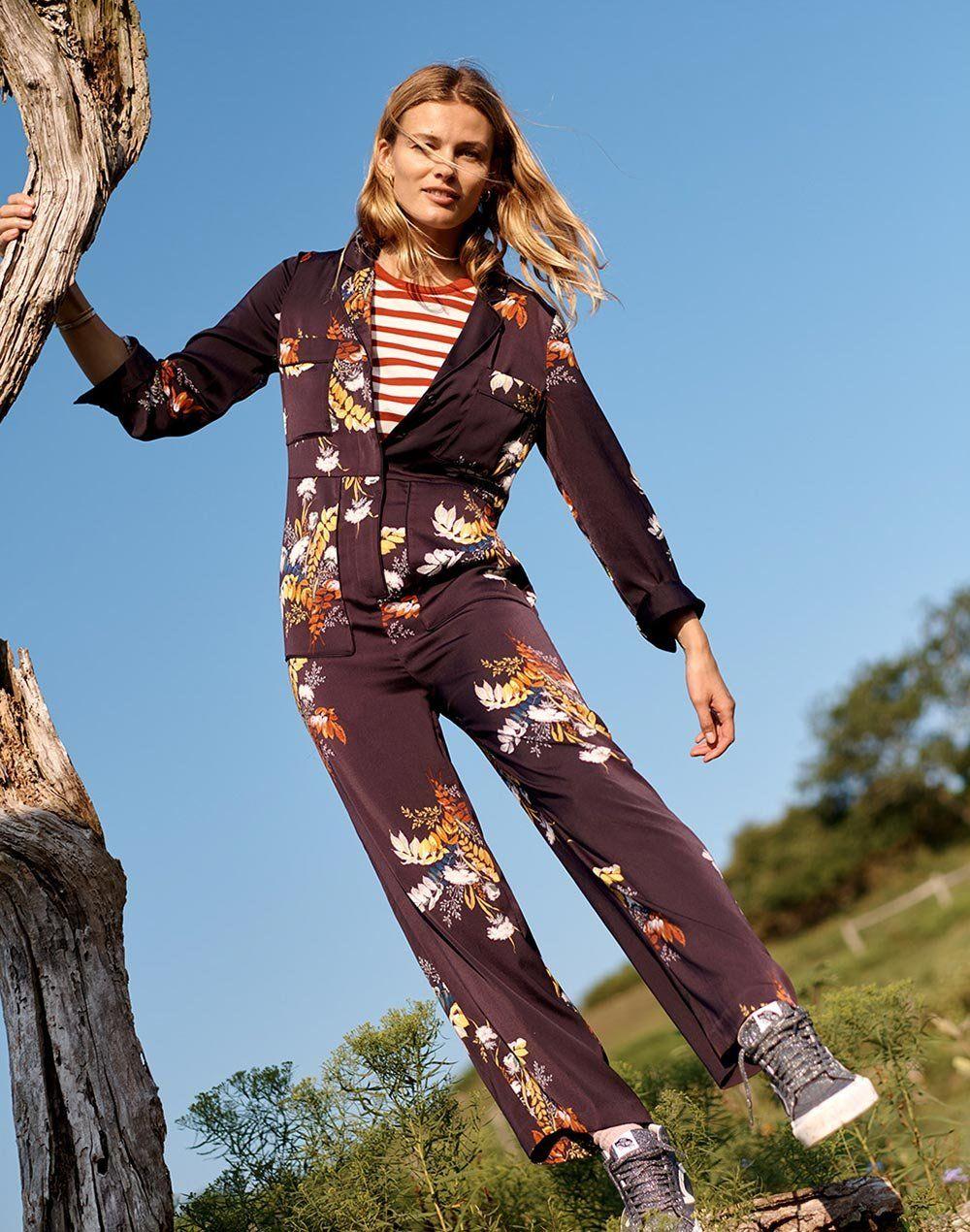 aa14a31b2560 madewell satin pajama jumpsuit worn with northside vintage tee + vans  high-top sneakers.