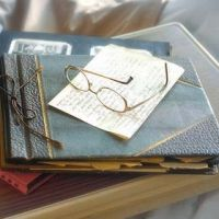 Photo Album And Glasses On A Hospital Bed  Healthy Aging