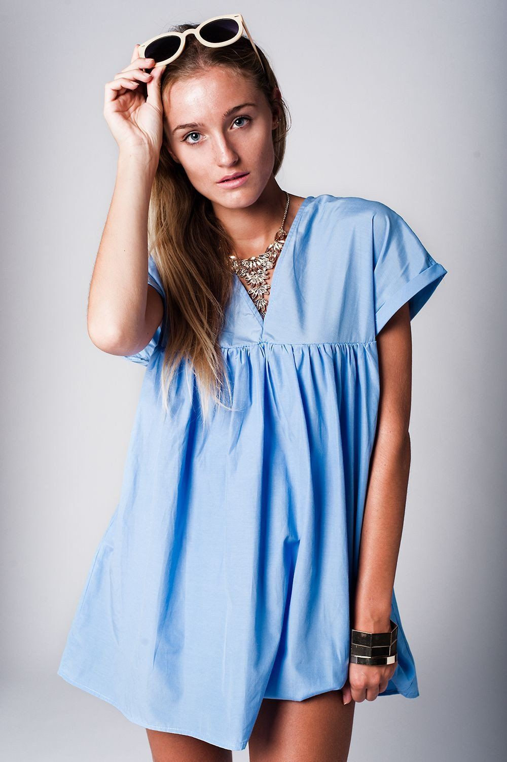 Blue babydoll dress with v neck and cut out back products