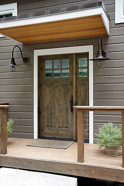 Simple Stunning Front Door Design With Iron Sconces And A
