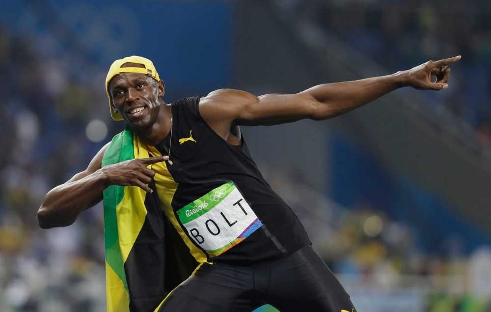 As it happened: Bolt powers to third-straight 100m gold on ...