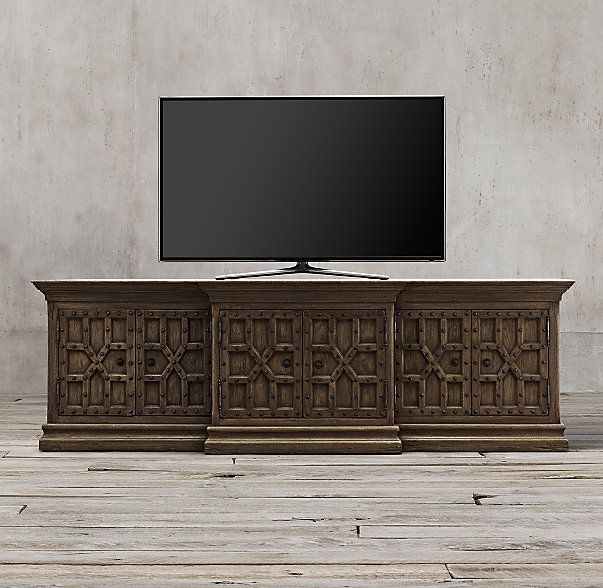 RH's 17th C. Castelló Media Console:Inspired by a late 17th-century design from Spain's Andalusia region, our cabinets capture the intricate geometric patterning and exuberant originality of its Moorish inspiration. Crafted from solid walnut with a gently aged patina, each piece is accented with hand-hammered wrought iron studs for textural contrast.