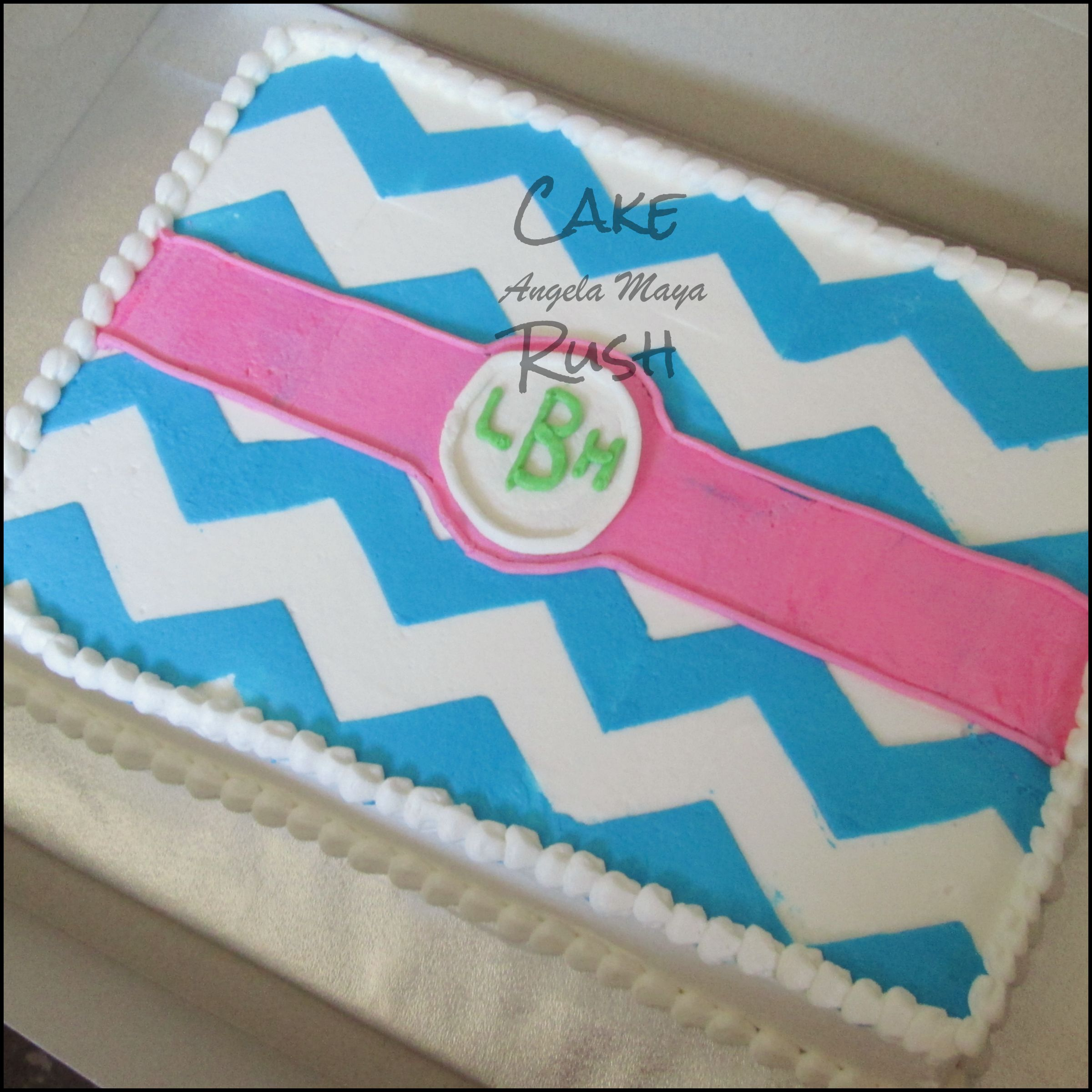 All butter cream sheet cake with bright blue chevron design and