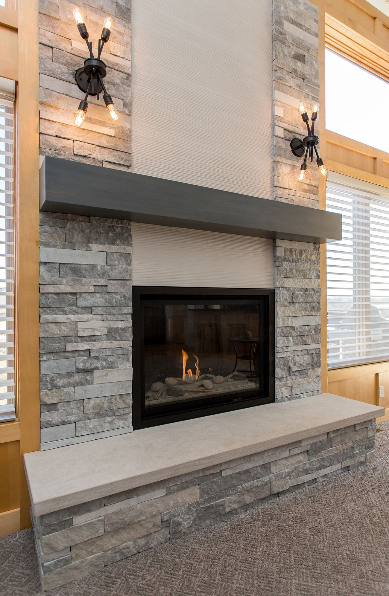 An Appealing Mix Of Materials Stacked Stone Linear Tile And Limestone Were Curated To C Linear Fireplace Stacked Stone Fireplaces Stone Fireplace Surround