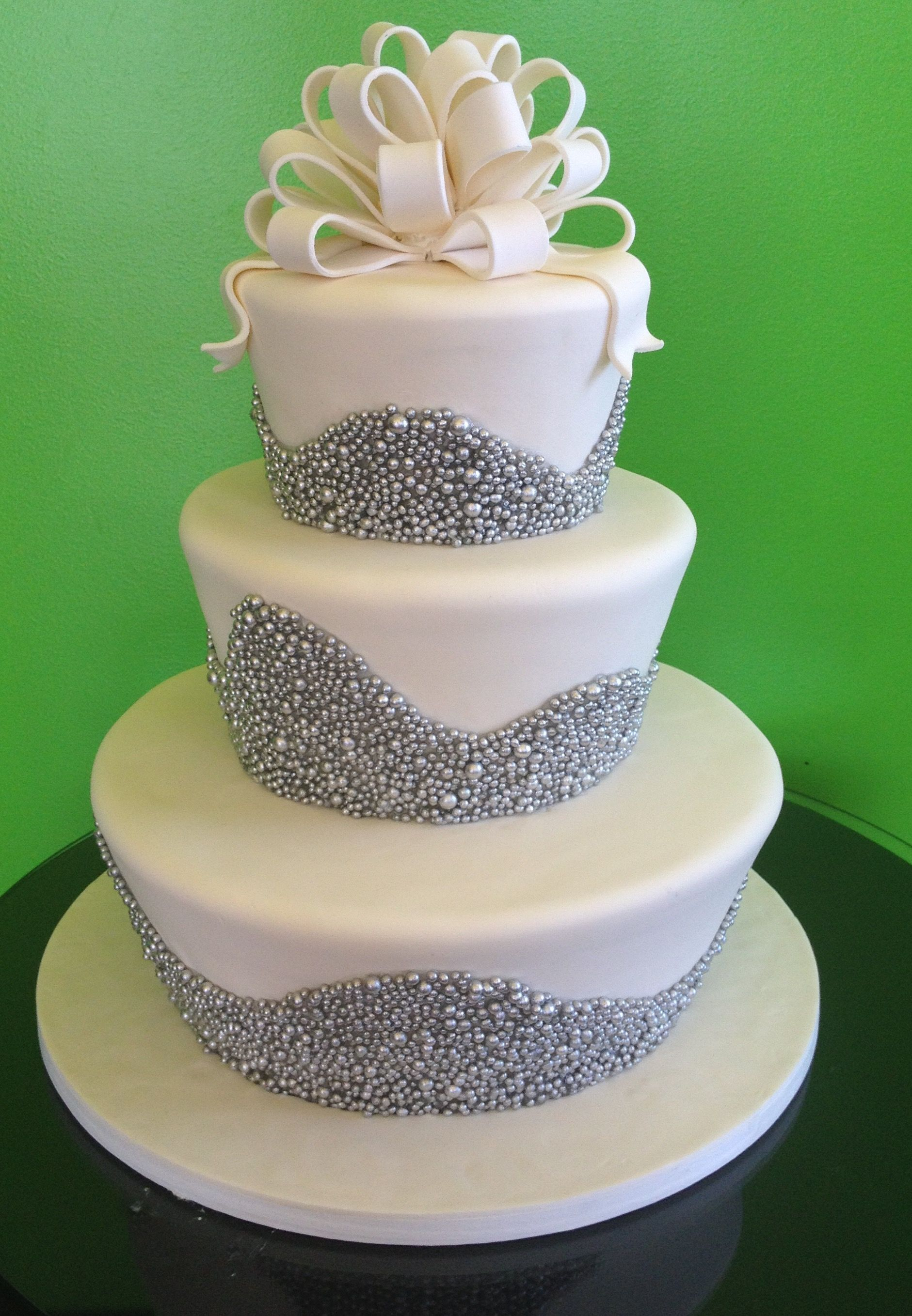 Fun Flared Three Tiered Wedding Cake With White Fondant Bow And
