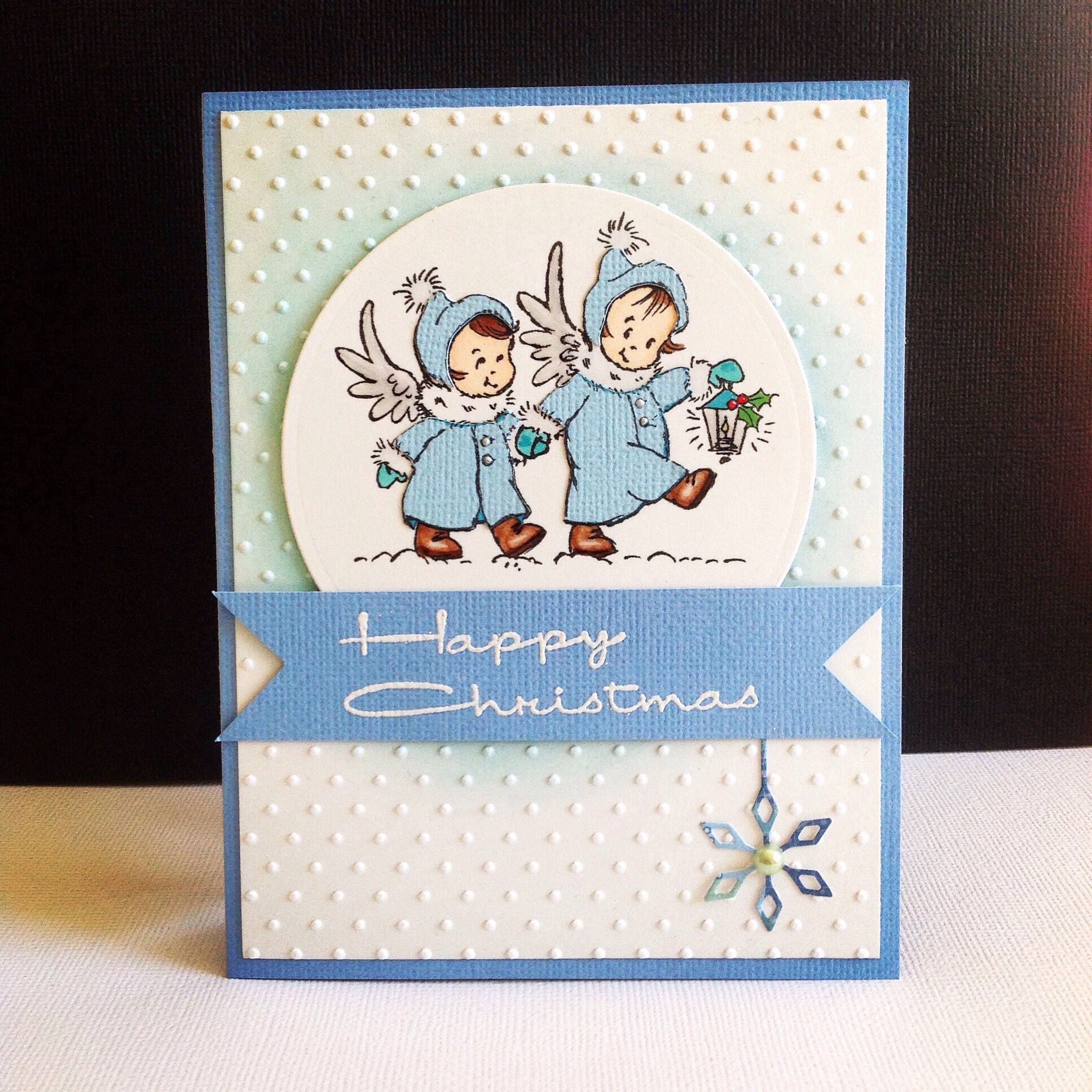 Christmas card I used  cling little angels stamp from Stampendous and swiss dots embossing pad.