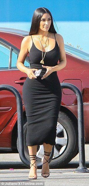 4e82a11b3319 Kim Kardashian pours curves into clingy black knit dress  dailymail