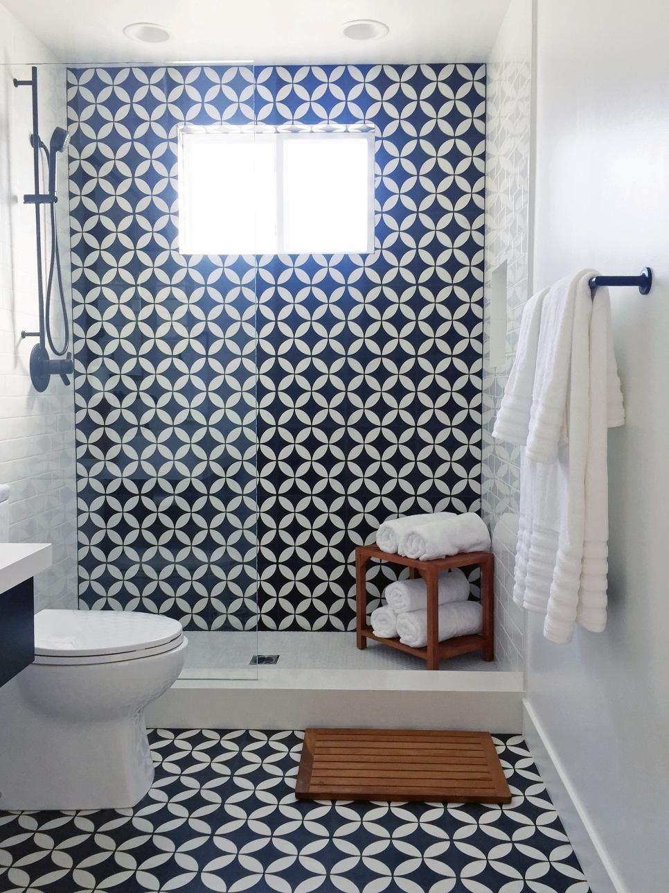 this small bathroom was remodeled with black-and-white patterned