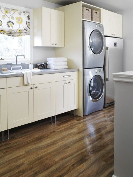 Light And Airy Laundry Room Light Cabinetry Dark Wood Floors Ample Storage And