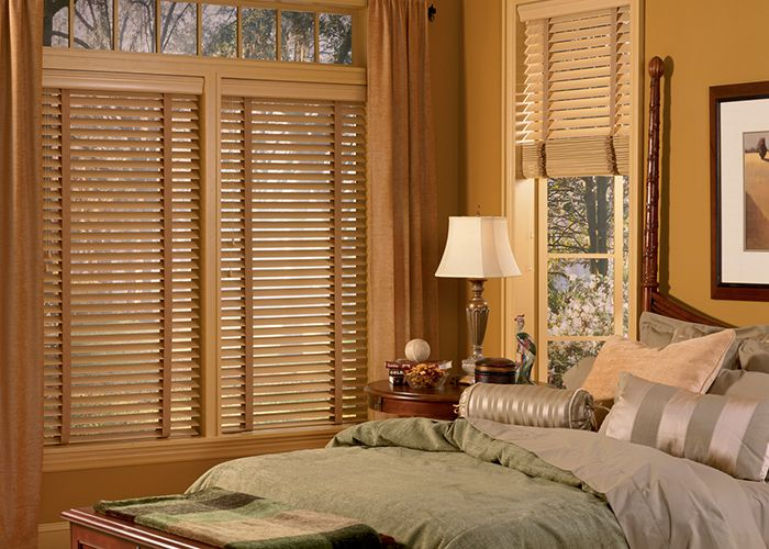 Add lavish Faux Wood Blinds to your bedroom - Enhance the décor by darkening and properly insulating your bedroom with the perfect room setting effect by energy efficient elegant Faux Wood blinds.