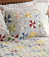 Pinwheel Quilt -- Love the use of the stripe (ticking/seersucker) for sashing!