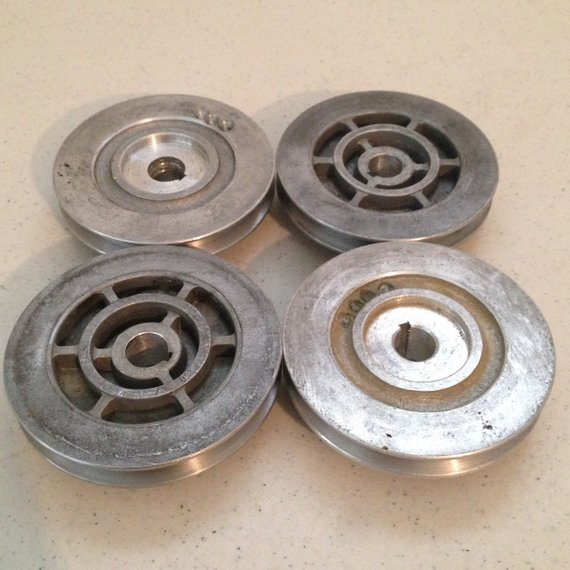 Set of 4 Vintage Industrial Small Metal Pulley Wheels