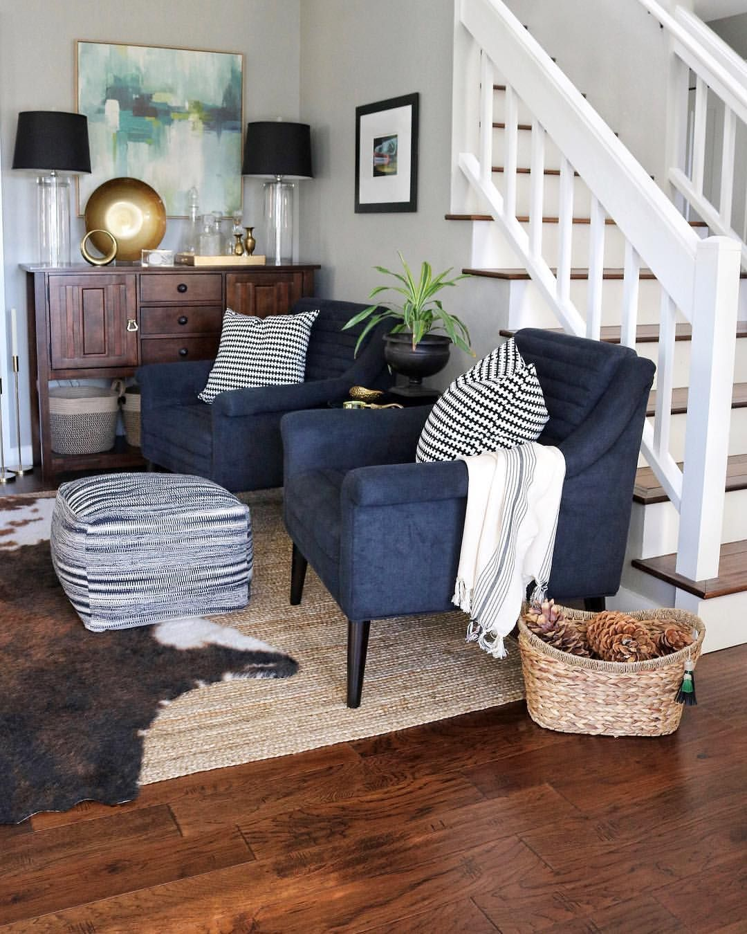 Living Room with Abstract Art, Navy Chairs, Jute Rug, & Faux Cowhide #havenlylivingroom