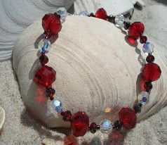 Ruby red crystals with Swarovski crystals mixed to make a beautiful bracelet :). Theriveracollection.com