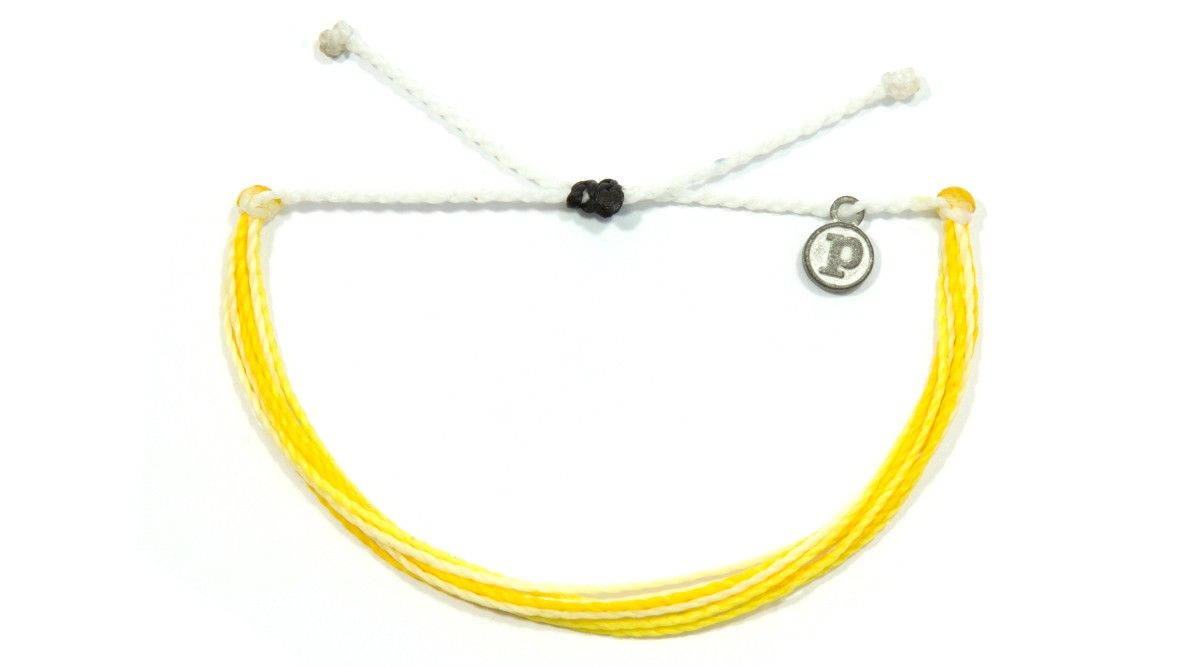 """HoneyLove bracelet by Pura Vida - $1 donated :) - 100% waterproof - wax-coated - iron-coated copper """"P"""" charm - adjustable from 2-5 inches in diameter  Every bracelet is 100% waterproof. Go surf, snowboard, or even take a shower with them on. Wearing your bracelets every day only enhances the natural look and feel. Every bracelet is unique and hand-made therefore a slight variation in color combination may occur."""