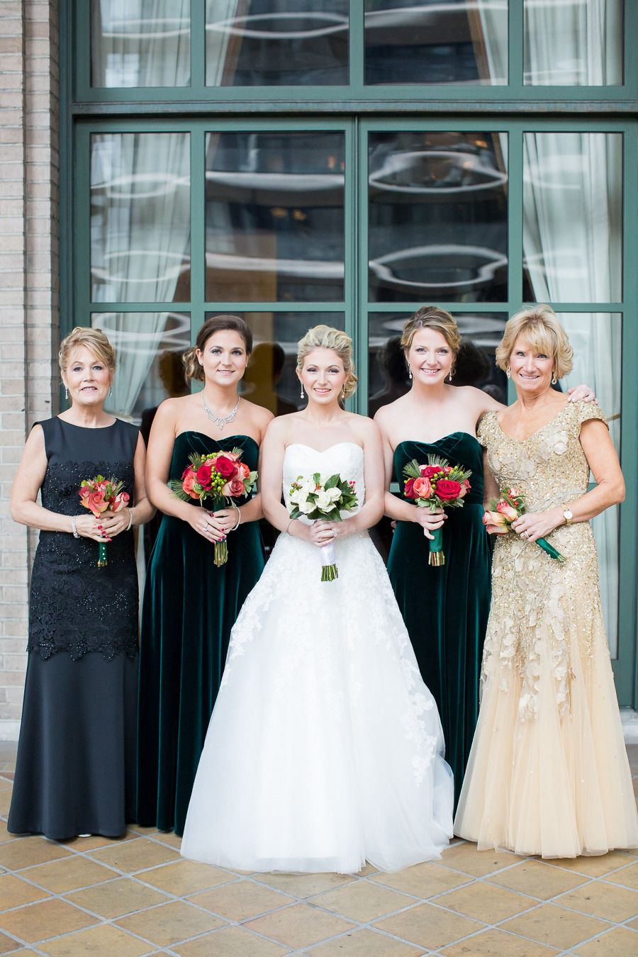 845ba0e252c Mother of the bride and mother of the groom compliment the holiday shades  of this beautiful winter wedding